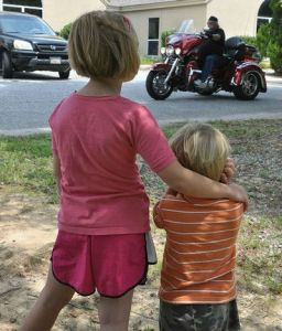 child holding ears loud motorcycle cropped